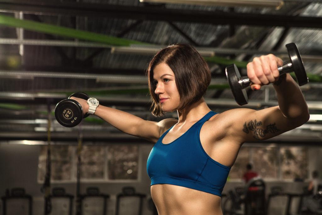 Full body workout, dumbbell raises