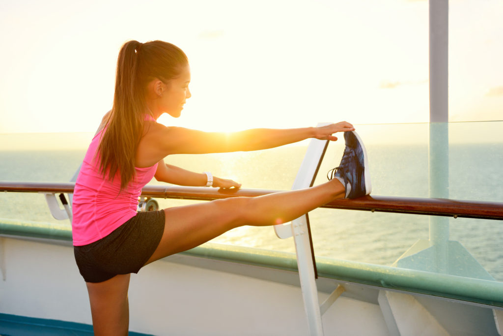 A girl stretches her calves before exercise