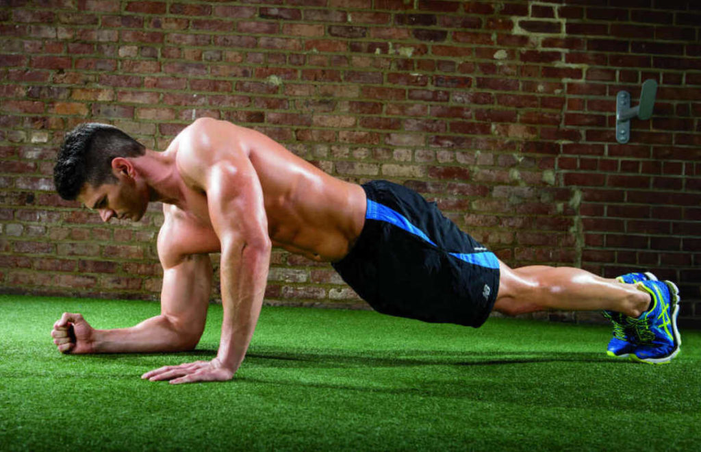A man doing Single-Arm Plank Up/Downs