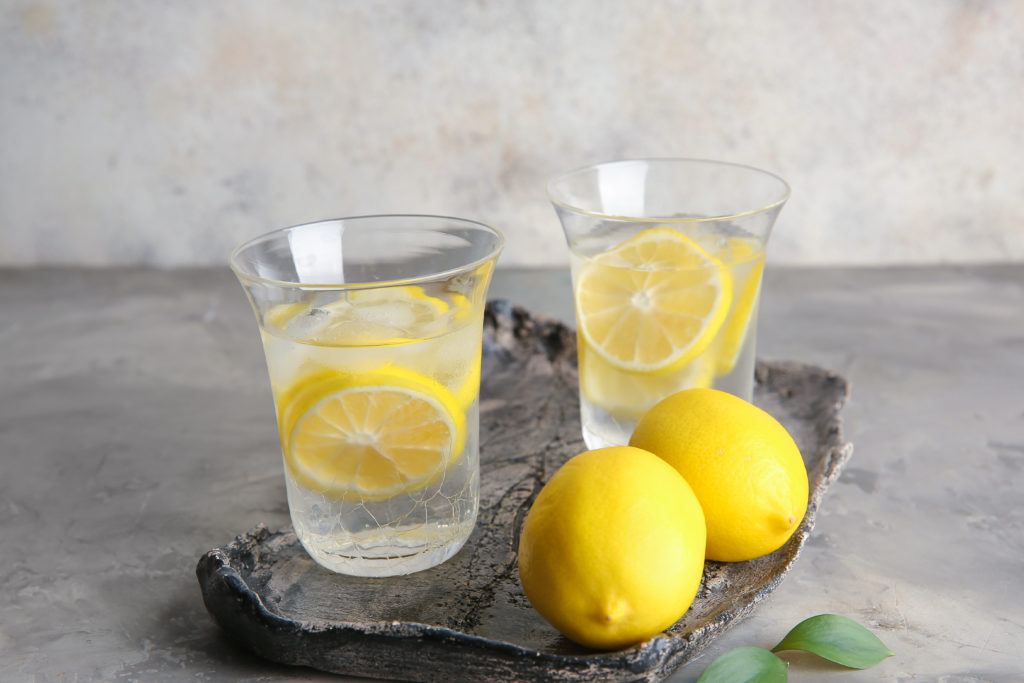 Two glasses with water and lemon slices