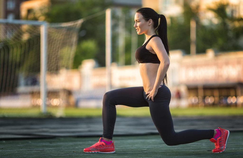 A girl doing split squats