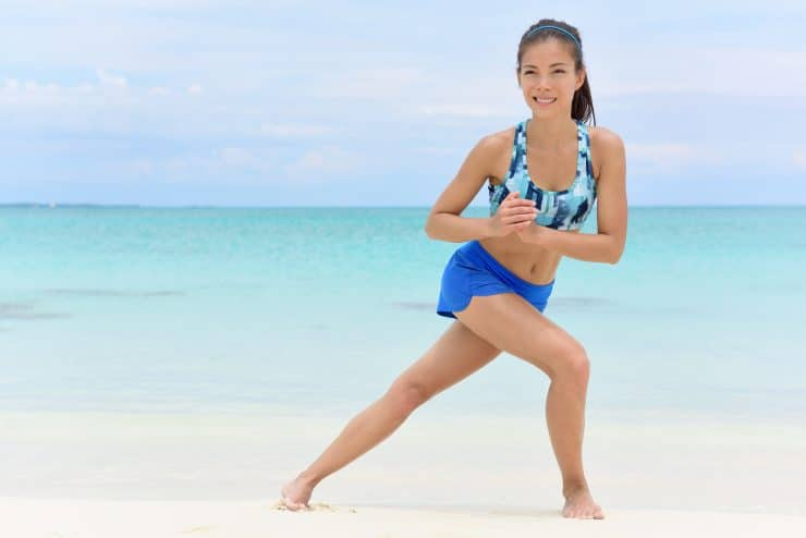 A woman doing curtsy lunge