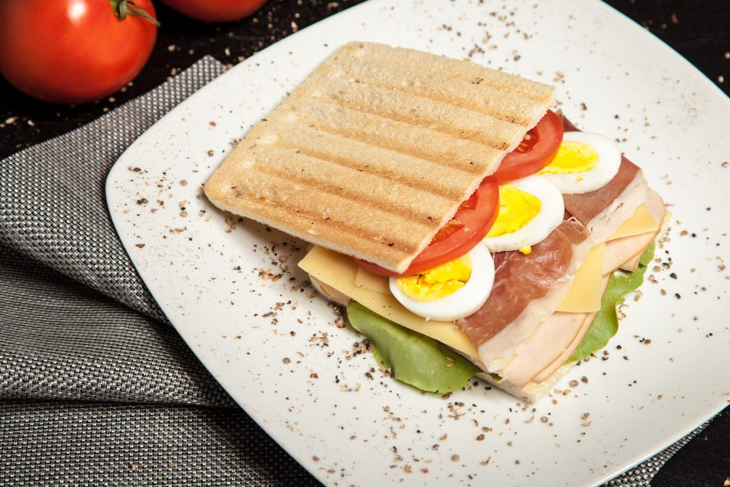 A toast with eggs and tomatoes