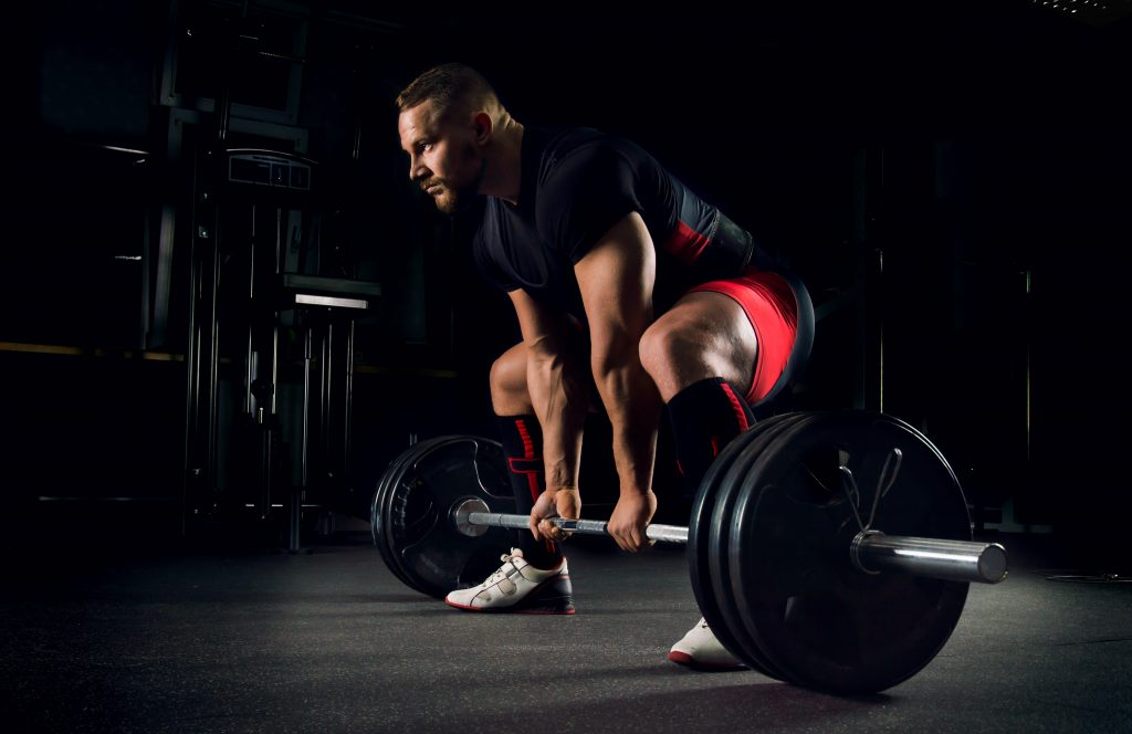 more reps or more weight to build muscle