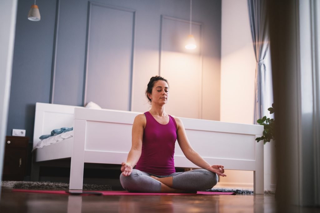 a woman performs Morning Breathing