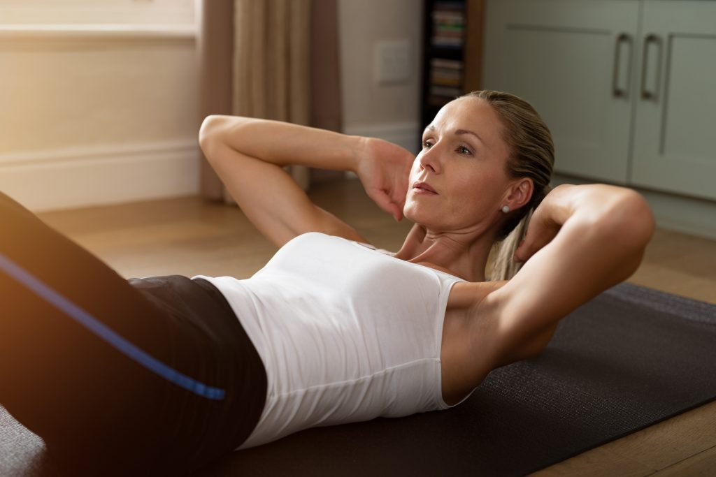how to tighten core when working out