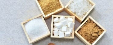 how much natural sugar per day