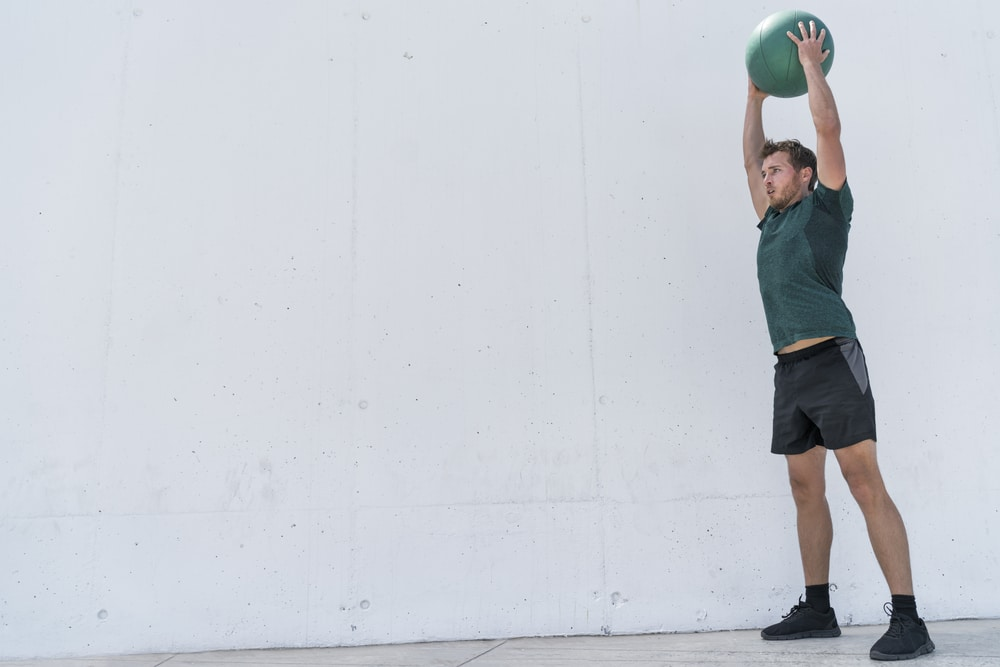benefits of ball squat with overhead press